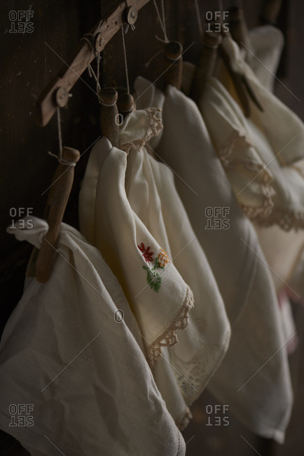 Linen cloths hanging on clothespins