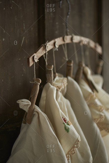 Linen cloths hanging by clothespins