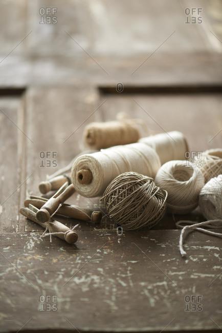 Clothespins and yarn on old door