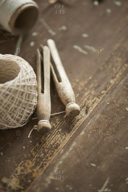 Yarn and clothespins on door