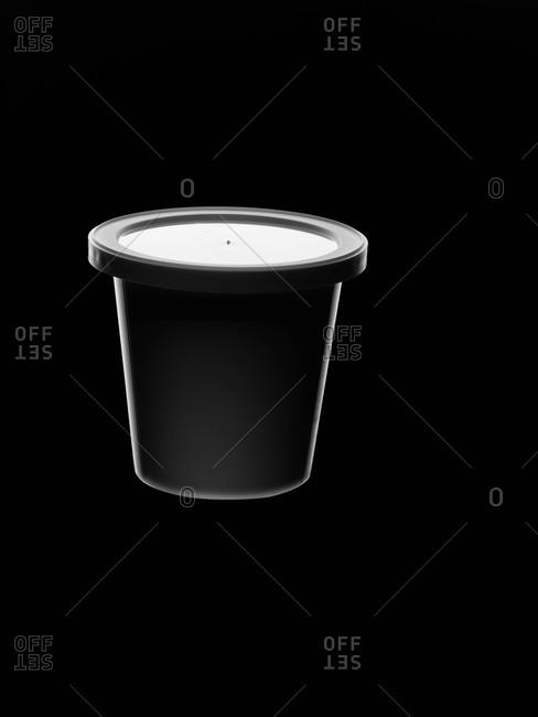 Yogurt container on black background