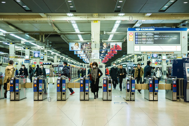 Osaka, Japan - March 26, 2015: Commuters coming and going in Japanese rail station