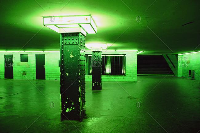 A bright green subway passage