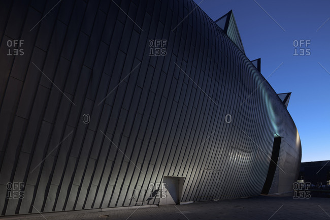 Helsinki, Finland - March 31, 2015: The curved exterior wall of the museum of modern art in Helsinki, Finland at dusk
