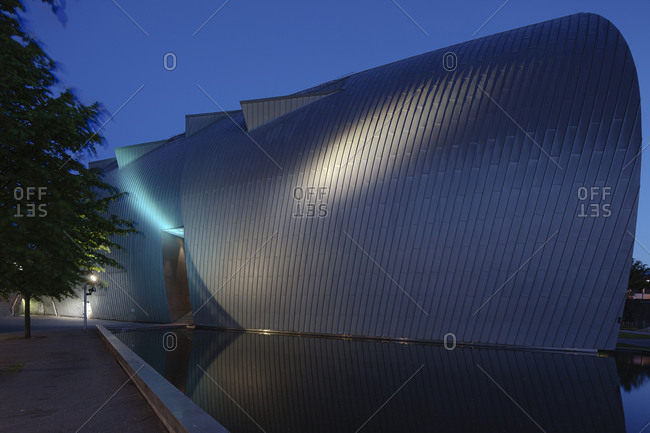 Helsinki, Finland - March 31, 2015: A rounded wall of the modern art museum in Helsinki at dusk