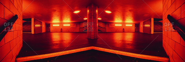 A red passage in a subway station