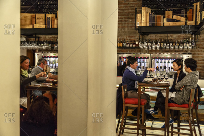 Santiago, Chile - September 23, 2014: Patrons at wine bar in Santiago, Chile