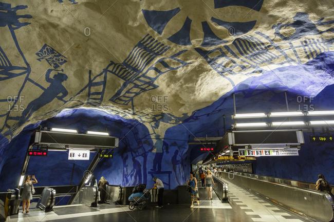 Stockholm, Sweden - July 28, 2014: People at T Bana metro station, Stockholm, Sweden