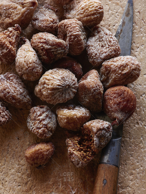 Dried figs with cutting knife