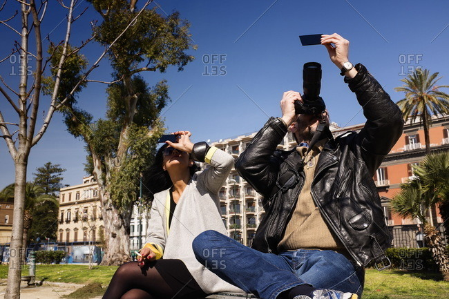 Naples, Italy - March, 20th 2015: Couple watching solar eclipse
