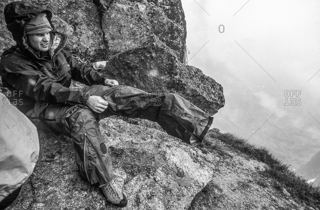 Climber prepares for rain in Canadian mountains