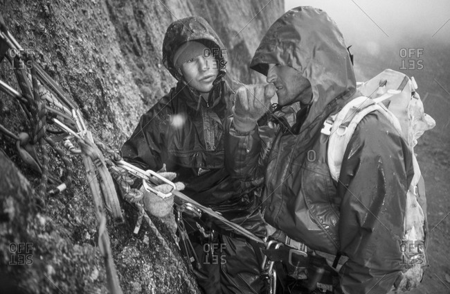 Climbers prepare to descend in rain storm in Canadian mountains