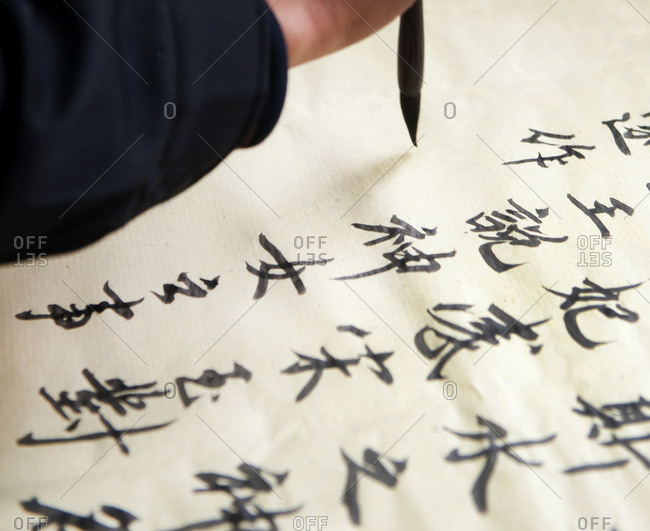 Close up of calligraphy artist painting Chinese characters in Beijing