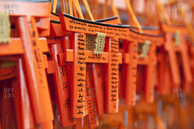 Wishes and prayers on miniature torii gates, Japan