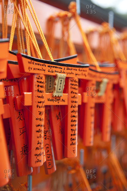 Wishes, prayers on miniature torii gates, Japan