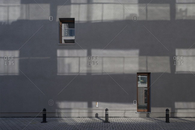 A minimal concrete wall with a door and a window