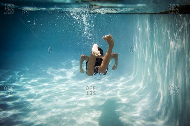 Underwater view of a child swimming