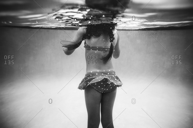 Underwater view of a girl in a swimming pool