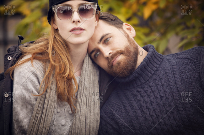 Portrait of affectionate couple in cable-knit sweaters
