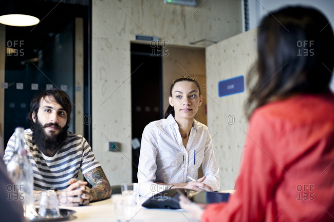 Young professionals in a meeting at a conference table