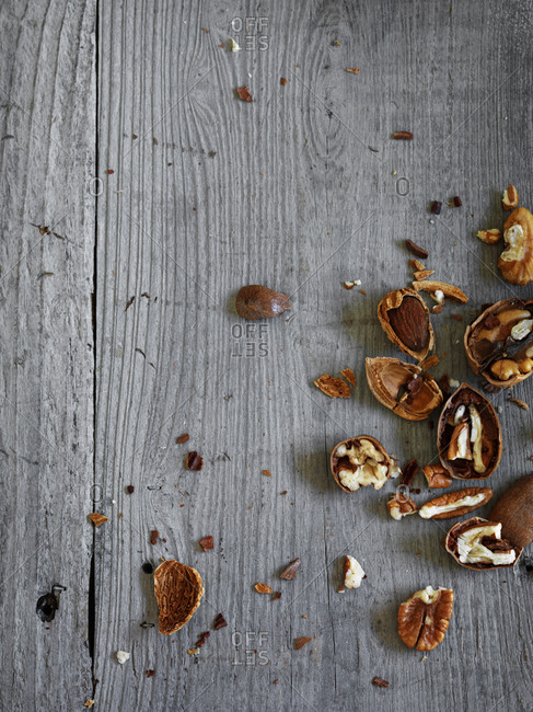 Crushed walnuts on a wooden table