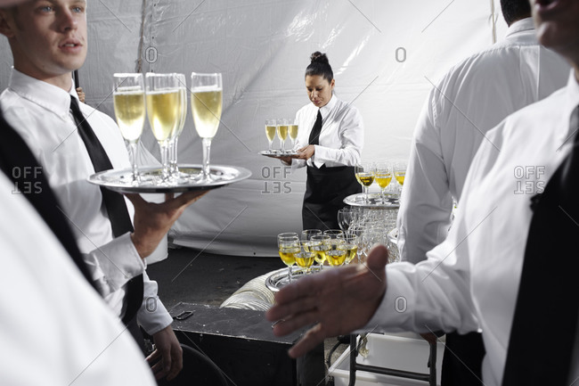 October 20, 2012: Waiters with trays of champagne