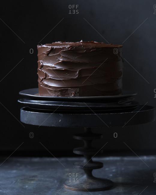 Carmel sauce dripping onto a chocolate cake