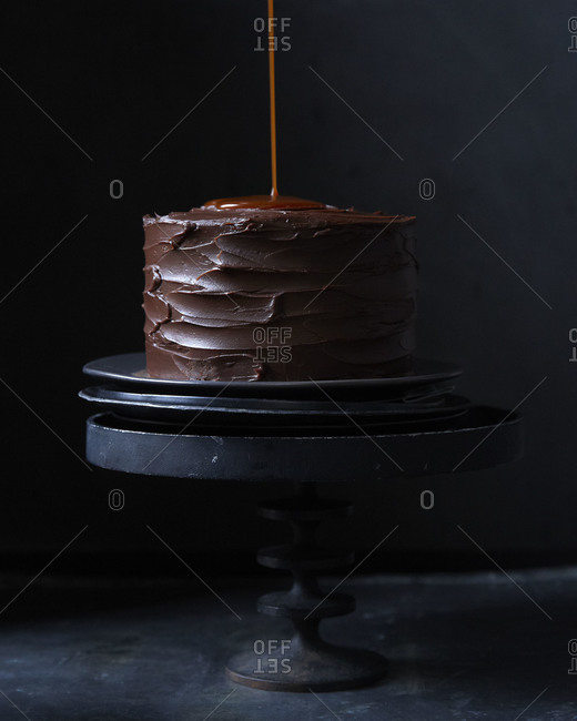 Carmel sauce dripping off the edge of a chocolate cake