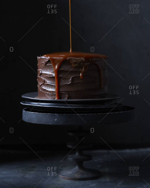 Carmel drizzling down the side of a chocolate cake