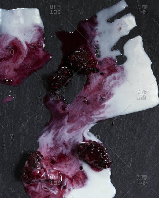 Melted remnants of raspberry and cream popsicles