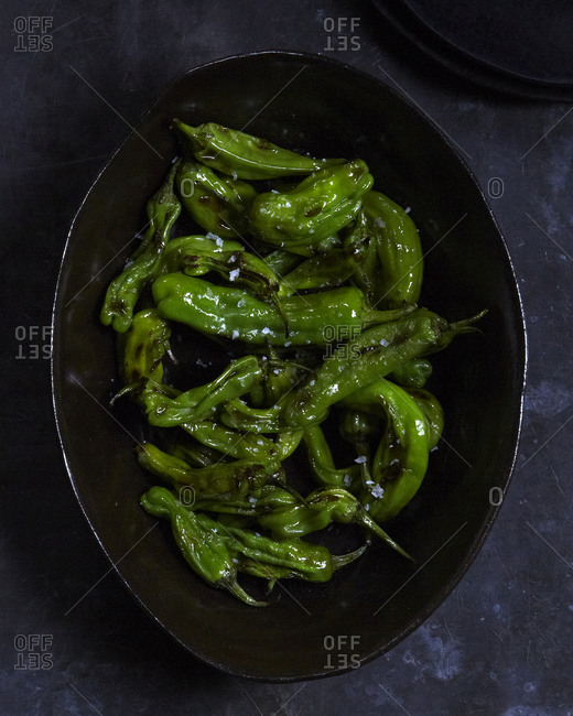 Stir-fry shisito peppers