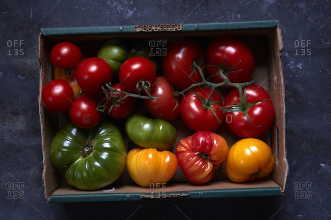 Tomatoes in a cardboard crate