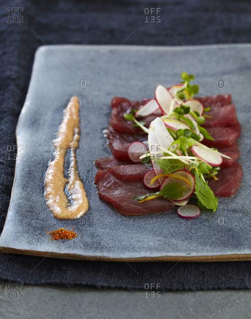 Tuna sashimi topped with radishes