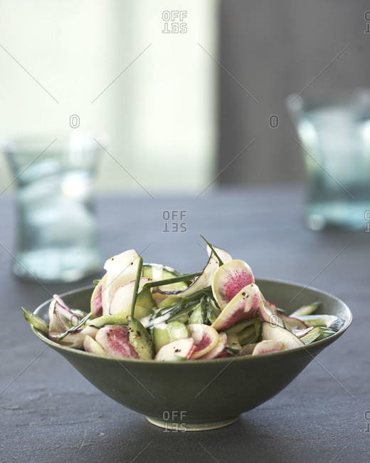 A salad of radishes, peppers and chives