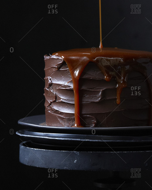Carmel pouring off the edge of a chocolate cake