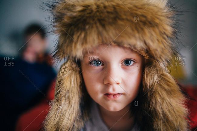 Portrait of a boy in a furry hat