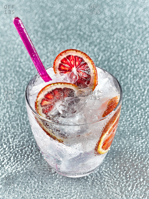 Fizzy cocktail with blood orange slices