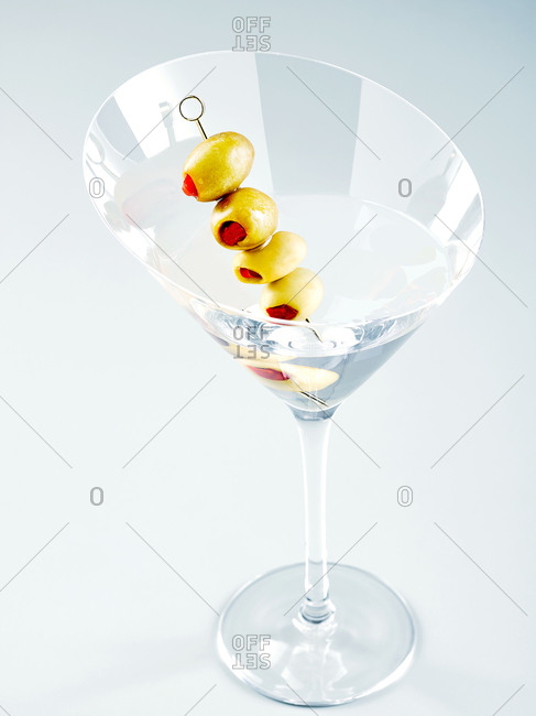 Glass of martini with olives