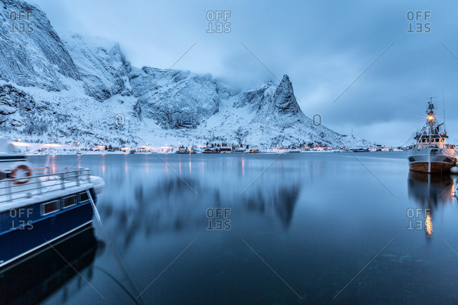 Ships moored in the small harbor of Reine in the Lofoten Islands, Norway