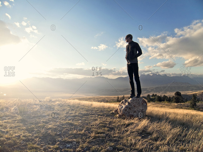 Young man watches sunset over Jackson Hole, Wyoming valley