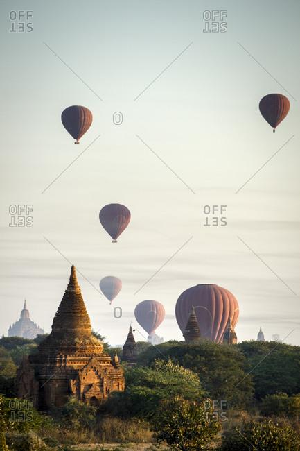 Hot air balloons over temples of Bagan, Myanmar at sunrise