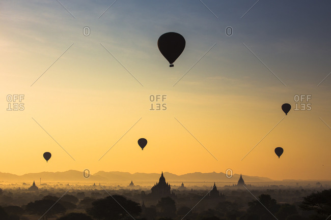Hot air balloons floating over temples of Bagan, Myanmar