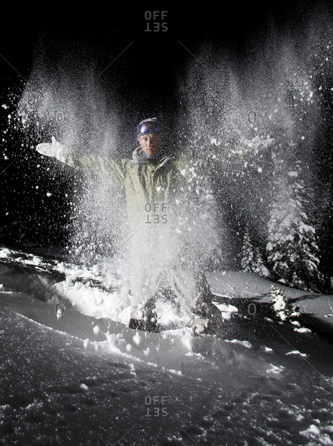 Man throws snow up in the air  on Teton pass