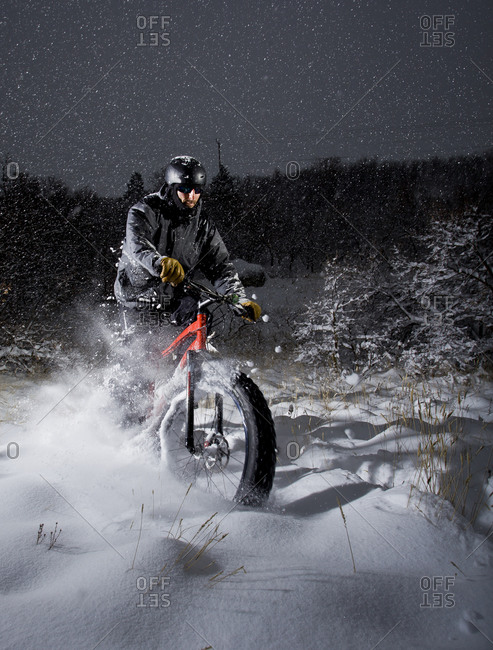 Man rides his fat tire bike through deep powder snow