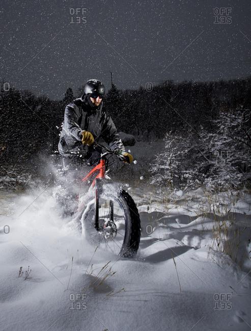 Man rides his fat tire bike through deep powder snow