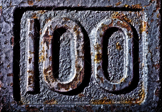 Close-up of number on 100 pound dumbbell