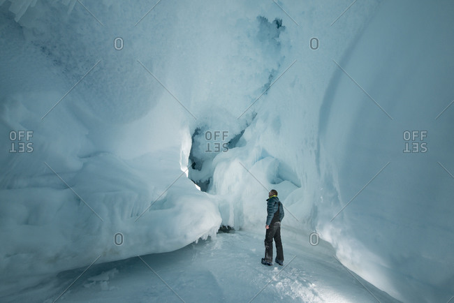 Man explores interior of ice cave on Ross Island, Antarctica