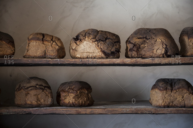 Loaves of bread cooling on shelf in Villar-d'Arene, France