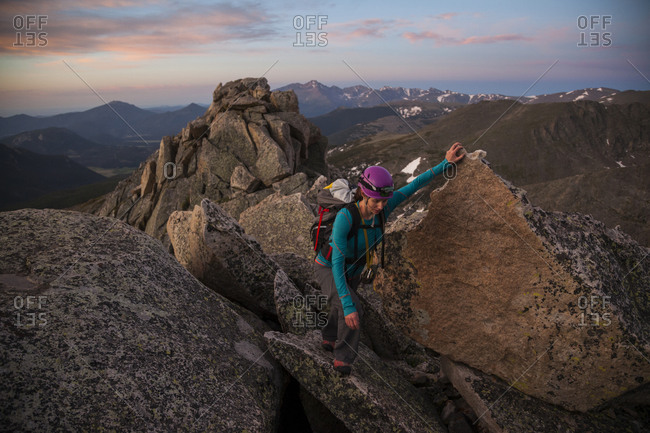 Woman climbing Blitzen Ridge at sunrise, Rocky Mountain National Park