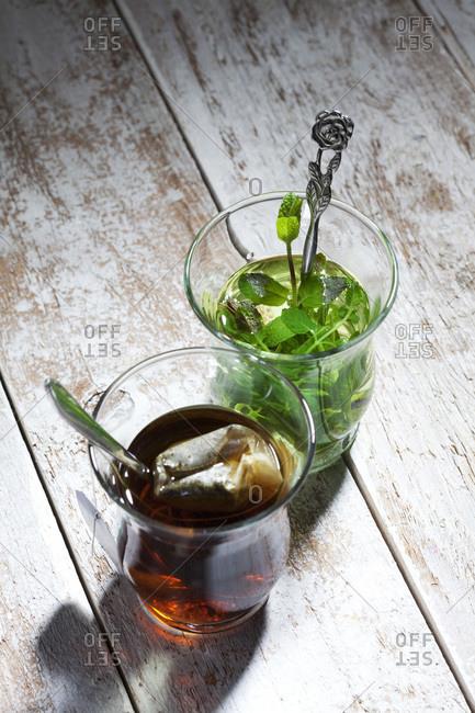 Two glasses of fresh pepper mint tea and tea bag